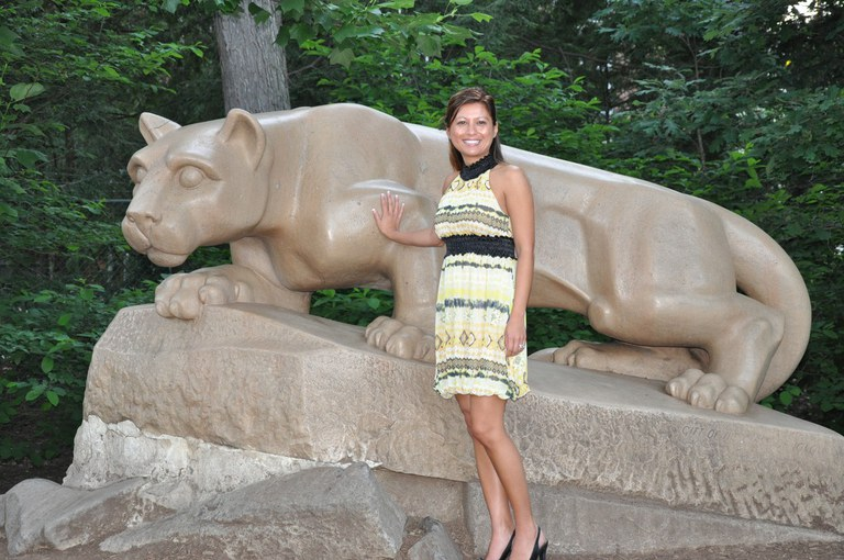 While attending the Summer Institute, a CEDEV student gets a photo opportunity with the lion shrine at University Park.